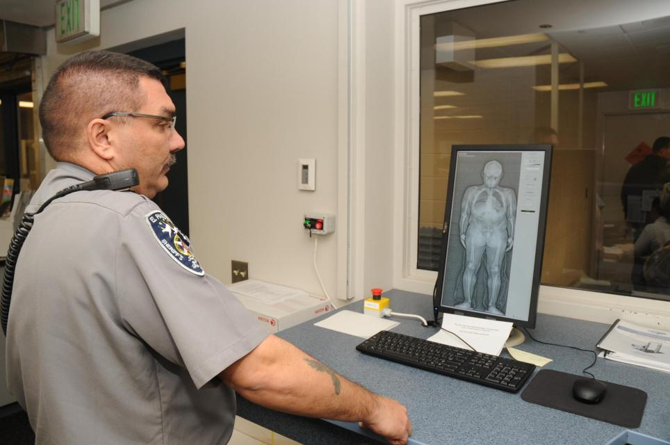 Intake Deputy Using Body Scanner